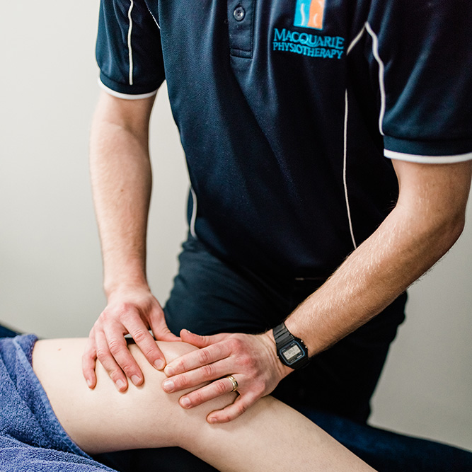 physiotherapists massaging a knee